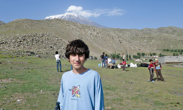Crescenta Valley High School freshman Sebouh Oshagan with the peak of Mt. Ararat in the background. Sebouh climbed Mt. Ararat in August of 2012, when was 13-years-old. He will relay his story of climbing the mountain on Wednesday at the Glendale Central Library.