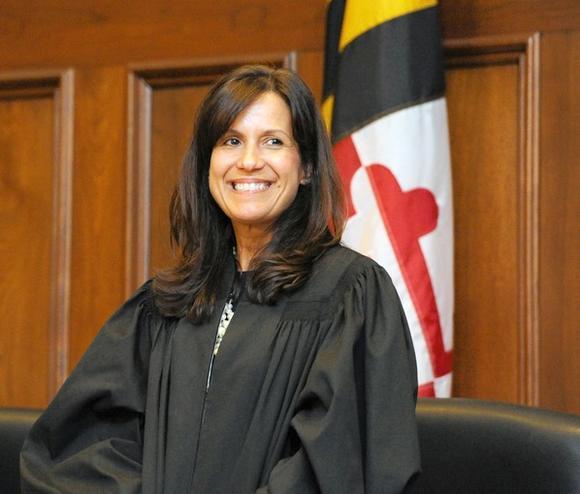 yolanda l  curtin sworn in as first hispanic judge on