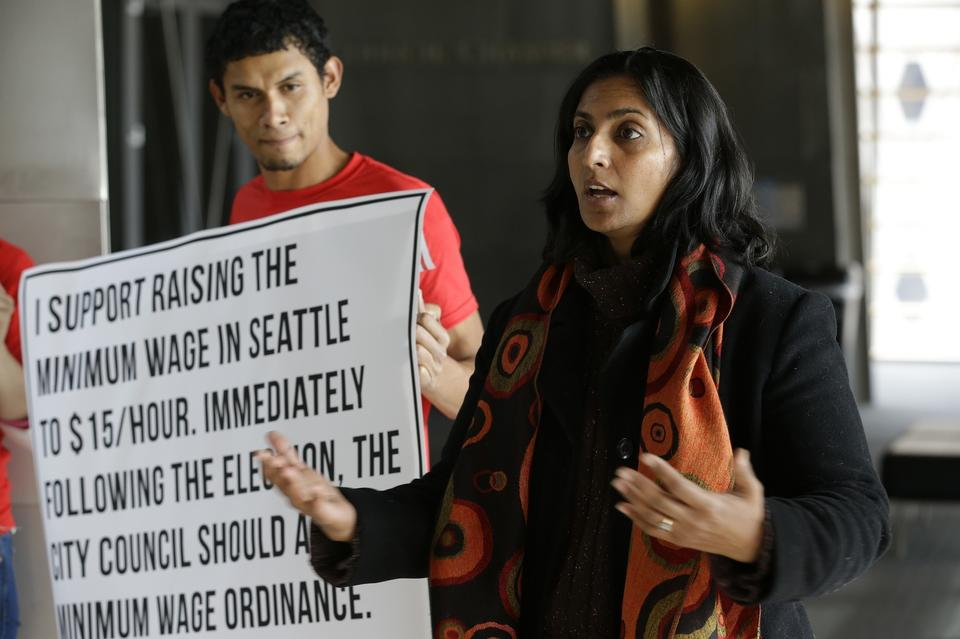 Kshama Sawant campaigns in Seattle, emphasizing her support for raising the minimum wage to $15 an hour for all workers in the city.