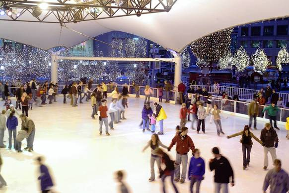 Surrounded by thousands of twinkling lights in the trees, skaters enjoy the open-air Ice Terrace at the Crown Center.