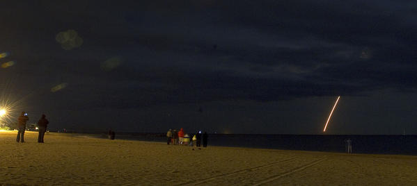 Spectators gather on Buckroe Beach Tuesday evening to a Minotaur 1 rocket launche from Wallops Flight Facility of the Eastern Shore. The rocket was carrying a payload for the Air Force.