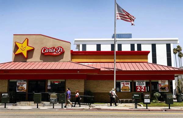 CKE will change hands to an affiliate of Roark Capital Group, a private equity firm in Atlanta. Above, a Carl's Jr. restaurant in Los Angeles.