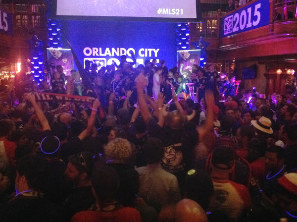 Fans gathered on Church St. in downtown Orlando for the official announcement of a new Major League Soccer team in Orlando on Tuesday, Nov. 19, 2013.