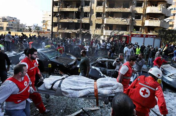 Lebanese Red Cross workers remove a body after the bombings at the Iranian Embassy in Beirut.