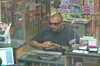 """Surveillance image of the """"Make it Quick"""" bandit."""" A Lennox man was charged Tuesday in the case, authorities said."""
