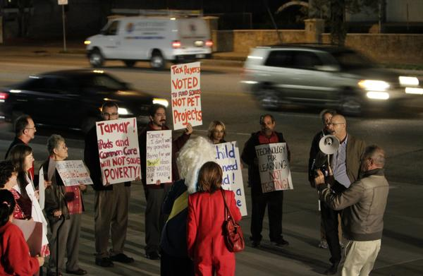 Parents and teachers protest outside the Valley Academy of Arts and Sciences in Granada Hills.