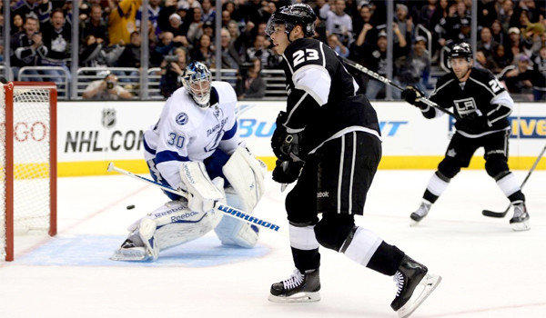 Kings captain Dustin Brown slips the puck past Lightning goalie Ben Bishop for his fourth goal of the season. The Kings defeated Tampa Bay, 5-2.