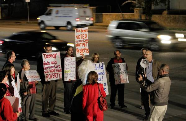 Protesters rally in Granada Hills over L.A. Unified's troubled iPad program.