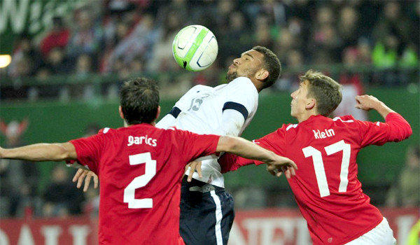 U.S. forward Terrence Boyd is surrounded by Austrian defenders Gyoergy Garics, left, and Florian Klein, right, during a friendly soccer match between Austria and the U.S. on Tuesday. Austria defeated the U.S., 1-0.