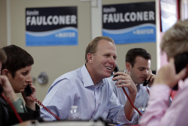 Councilman Kevin Faulconer makes phone calls to voters on mayoral election day in San Diego. He is the only Republican among the major candidates.