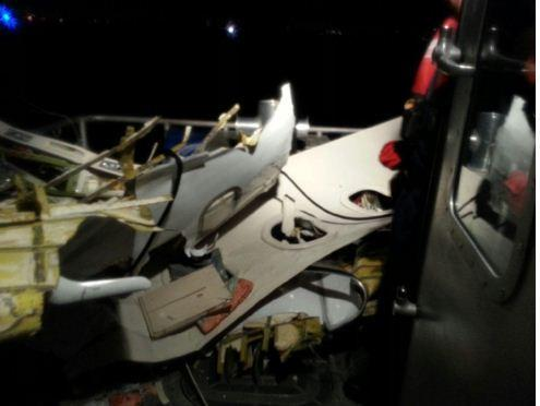 Wreckage of the plane that crashed off the coast of Fort Lauderdale, Fla., is brought aboard a Coast Guard boat Tuesday, Nov. 19, 2013.