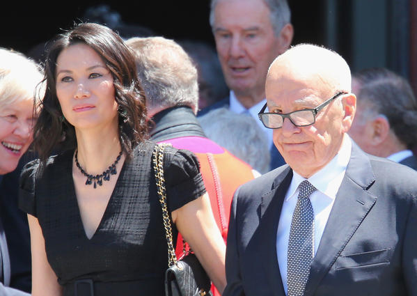 Rupert Murdoch and his wife Wendi Deng Murdoch leave after attending the Dame Elisabeth Murdoch public memorial at St Paul's Cathedral on December 2012 in Melbourne, Australia.