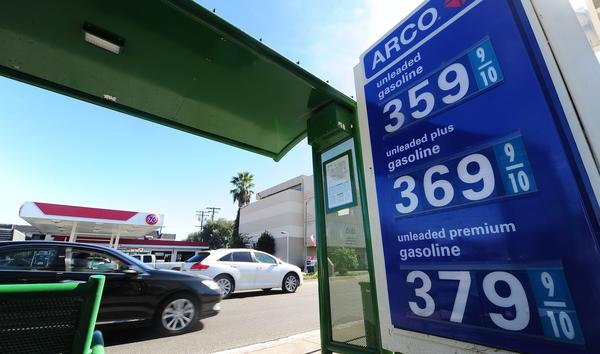 Gasoline prices are displayed at a station in Alhambra. The average price for a gallon of self-serve regular dropped to its lowest amount since Jan. 10 in Los Angeles County, according to the Automobile Club of Southern California.