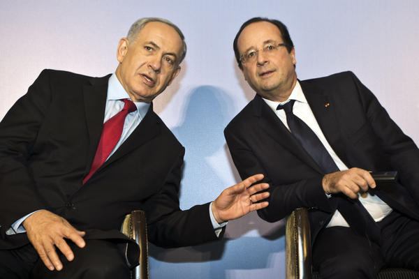 Israeli Prime Minister Benjamin Netanyahu, left, confers with French President Francois Hollande during a visit to a French-Israeli technology innovation summit at a hotel in Tel Aviv.