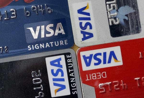 TransUnion reported that the average credit-card debt owed by consumers fell in the third quarter from a year earlier.