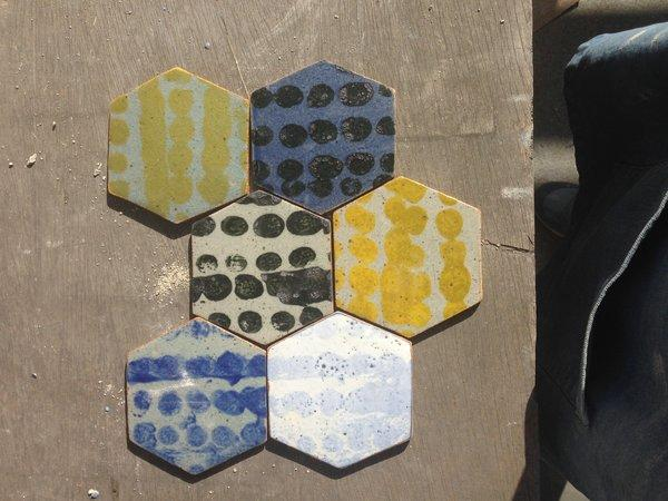 Painted ceramic coasters are among the wares sold by Bari Ziperstein's Bzippy & Co.