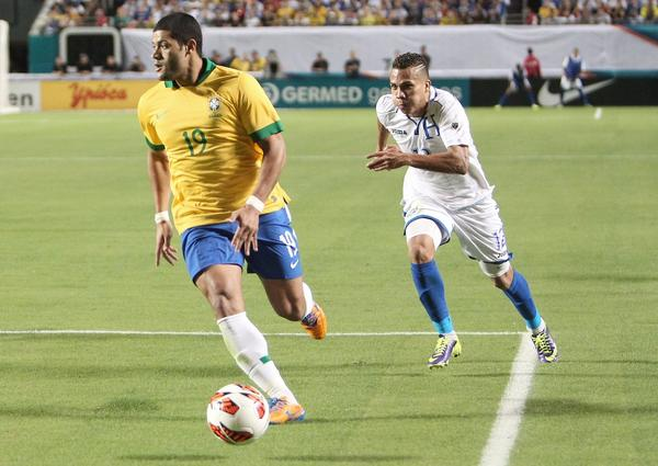 Arnold Peralta (12) chases Hulk (19) of Brazil during the second half of a friendly soccer match at Sun Life Stadium in Miami Gardens, Fla., on Saturday, Nov. 16, 2013.