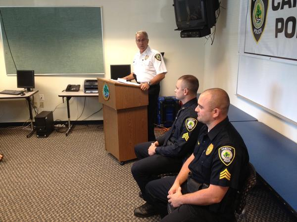 Canton police Chief Christopher Arciero, center, at a promotion ceremony last year for two of his officers. He was recognized recently by the Connecticut Coalition Against Domestic Violence.