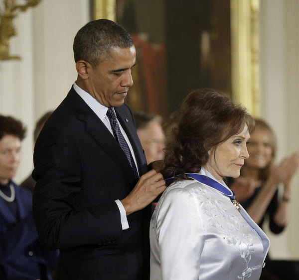 President Obama awards country music legend Loretta Lynn the Presidential Medal of Freedom on Nov. 20, 2013, during a ceremony at the White House in Washington.
