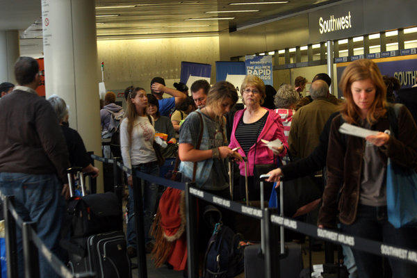 AAA says 7% of Thanksgiving travel will be by airplane this year. Above, Thanksgiving travelers wait to check in at Los Angeles International Airport in 2011.
