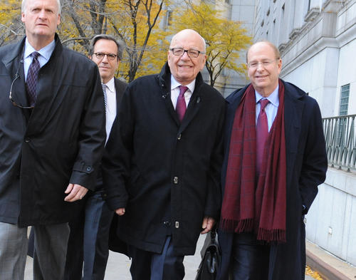 """Rupert Murdoch, center, exits state Supreme Court on Wednesday in New York.  Murdoch and his soon-to-be former wife said they were parting with """"mutual respect"""" Wednesday after telling a judge they had reached a divorce deal."""