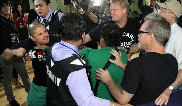 Manny Pacquiao trainer Freddie Roach, right, was involved in an ugly incident with members of the Brandon Rios camp Wednesday. Rios is not pictured.