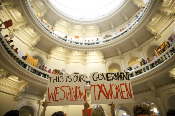 Abortion rights supporters rally on the floor of the state Capitol rotunda in Austin, Texas. A sharply divided Supreme Court on Tuesday allowed Texas to continue enforcing abortion restrictions that opponents say have led more than a third of the state's clinics to stop providing abortions.