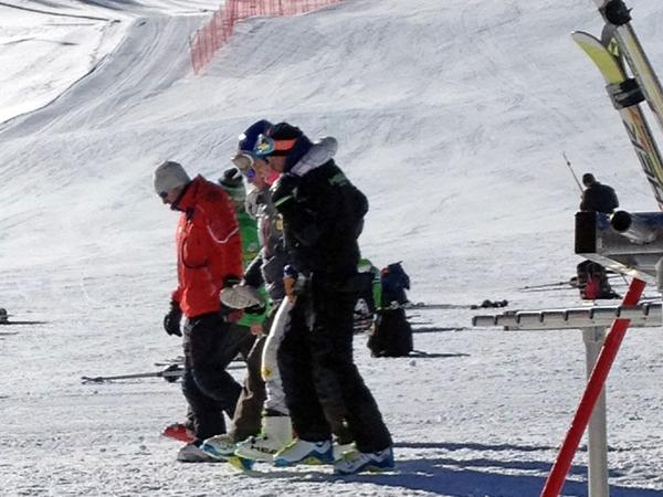 Lindsey Vonn, center, is helped off the slope after crashing during a run at Copper Mountain, Colo.