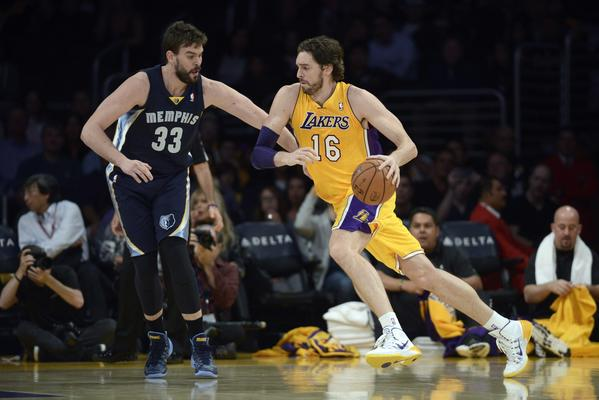 Nov 15, 2013; Los Angeles, CA, USA; Los Angeles Lakers center Pau Gasol (16) handles the ball defended by Memphis Grizzlies center Marc Gasol (33) during the first quarter at Staples Center.