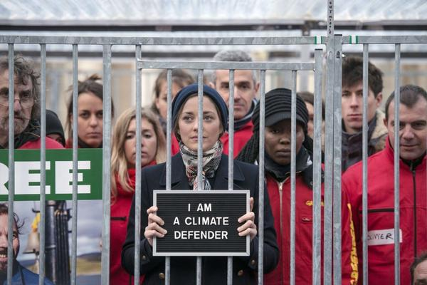 French actress Marion Cotillard stands with Greenpeace activists earlier this month in Paris.
