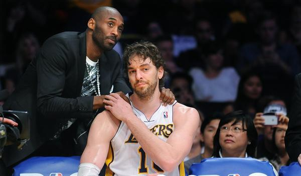 Kobe Bryant consoles Pau Gasol during a playoff loss against San Antonio last spring.