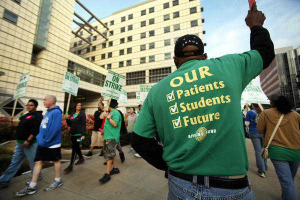 Alfred Rogers, right, a cardiovascular technologist, joins strikers Wednesday morning in front of the Ronald Reagan UCLA Medical Center. The one-day strike affected UC facilities throughout the state.