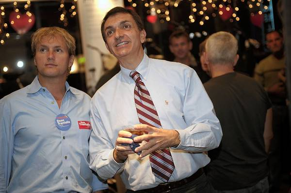 This 2009 photo shows Dean Trantalis, center, with his former partner Richard Smith, watching election returns in his unsuccesful mayoral race. File photo.
