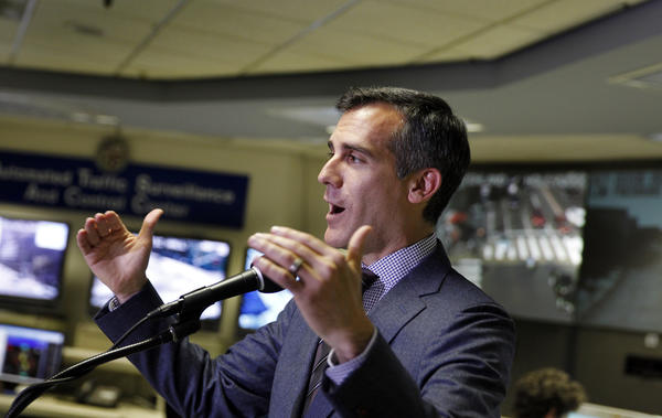 Los Angeles Mayor Eric Garcetti speaks at a news conference to mark his 100th day in office.