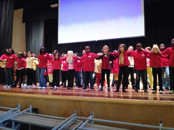 The Destiny Africa Children's Choir from Uganda performs a song with students at Duffy Elementary School.