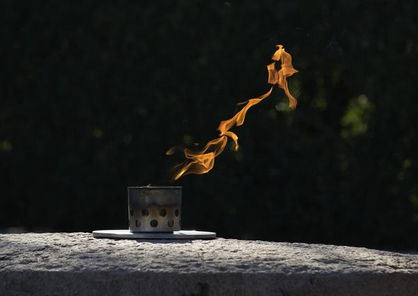 A flame burns over the grave of assassinated President John F. Kennedy at Arlington National Cemetery earlier this week.