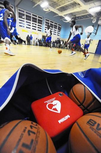 Johns Hopkins Medicine has donated portable Heartstart Defibrillator (AED) to Baltimore City Public Schools including middle schools. This AED, packed in an equipment bag, belongs to Roland Park Middle School, who took it on the road to Glenmount Middle School for their boys and girls basketball games.