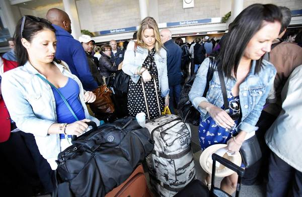 Without major investments to upgrade Los Angeles International Airport, every day at the facility will be as crowded as the day before Thanksgiving by 2033, a study predicts. Above, travelers crowd LAX in April.