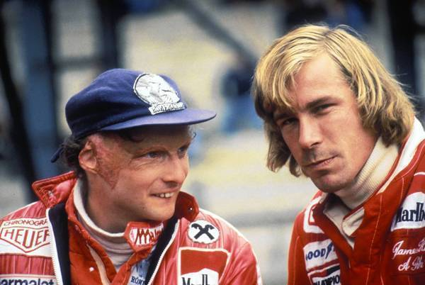 "Driver Niki Lauda of Austria, left, talks to rival James Hunt before the Belgian Grand Prix in 1977. His life is the basis of the film ""Rush."""
