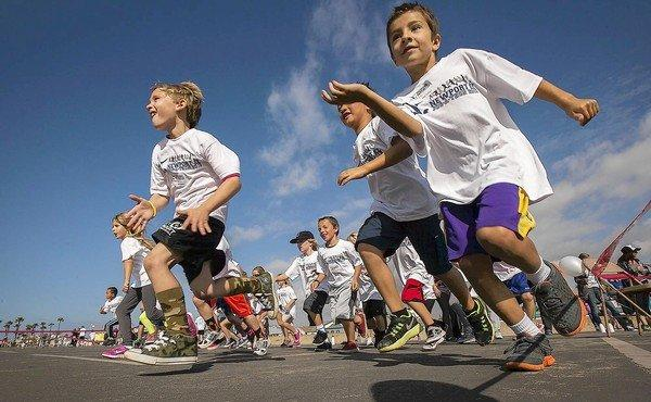 Students in Jan Mongkolkasetarin's first-grade class participate in Newport Elementary School's annual jog-a-thon on Wednesday.