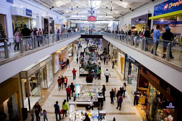 Shoppers walk through the Westfield North County Mall in Escondido, Calif. Retail sales beat expectations last month.