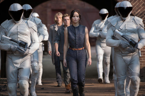 "Jennifer Lawrence, Josh Hutcherson, middle, and Woody Harrelson star in ""The Hunger Games: Catching Fire."""