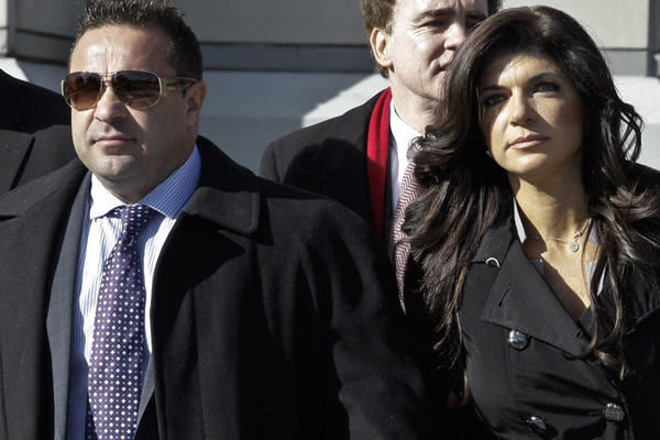 "Joe Giudice and his wife, Teresa Giudice, stars of ""The Real Housewives of New Jersey,"" leave federal court Wednesday in New Jersey."