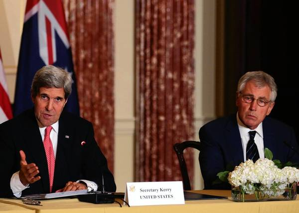 Secretary of State John F. Kerry, left, is joined by Defense Secretary Chuck Hagel at a news conference in Washington. Kerry said that the U.S. and Afghanistan had reached agreement on a security partnership after combat troops withdraw at the end of 2014.