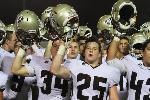 St. Francis High's football team recited its alma mater to the fans after defeating Culver City, 45-28, last week. The Golden Knights are hoping for a victorious encore this Friday versus Camarillo. (Tim Berger/Staff Photographer)