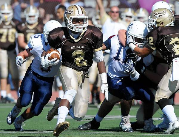 Bethlehem Catholic's Michael McDaniel (center) looks for room to run against the Liberty defense during their Lehigh Valley Conference high school football game Saturday, October 3, 2013.