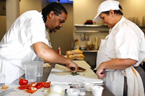 Anna Wilson, right, working with student Joey Thomas, is a case manager for Inspiration Corporation's food service training program at Inspiration Kitchens in Garfield Park.
