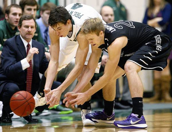 William and Mary's Omar Prewitt and High Point's Anthony Lindauer go after a loose ball Wednesday in Williamsburg.