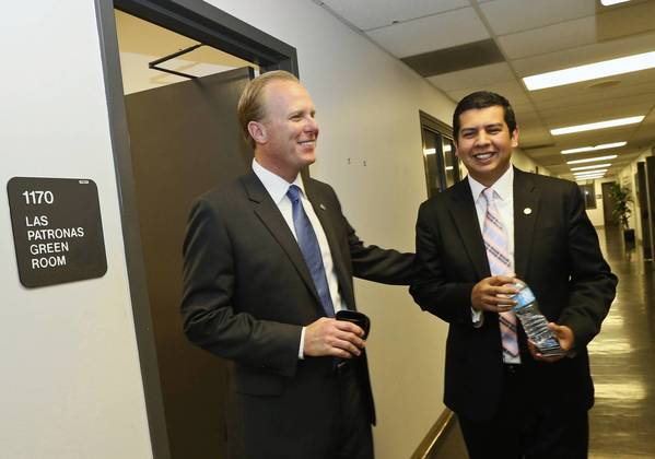 San Diego City Councilmen Kevin Faulconer, left, talks with Councilman David Alvarez. With all 581 precincts counted, Faulconer received 43.6% of the vote; Alvarez, 25.6%. About 34,500 provisional ballots remain to be counted.