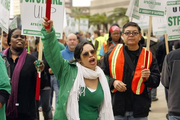 Union member Karla Salazar joins protesters in front of the Ronald Reagan UCLA Medical Center on Wednesday.